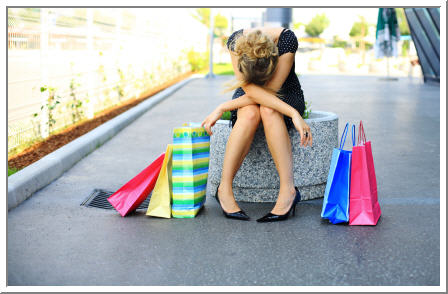 10 great reasons to hire a stylist, woman hates shopping, defeated shopping experience, woman with shopping bags, colorful shopping bags, upset woman, mad about shopping